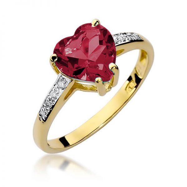 Pierścionek serduszko z żółtego złota z diamentami i rubinem