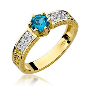 Pierścionek z żółtego złota z topazem i diamentami