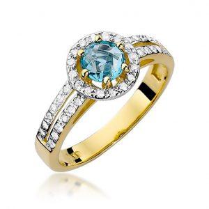Pierścionek z białego złota z topazem i diamentami